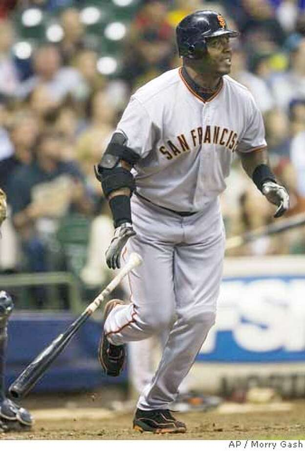 San Francisco Giants' Barry Bonds hits a three-run home run during the sixth inning of a baseball game against the Milwaukee Brewers Friday, Sept. 22, 2006, in Milwaukee. The home run was Bonds' 733rd career home run, tying Hank Aaron's National League record. (AP Photo/Morry Gash) Photo: MORRY GASH