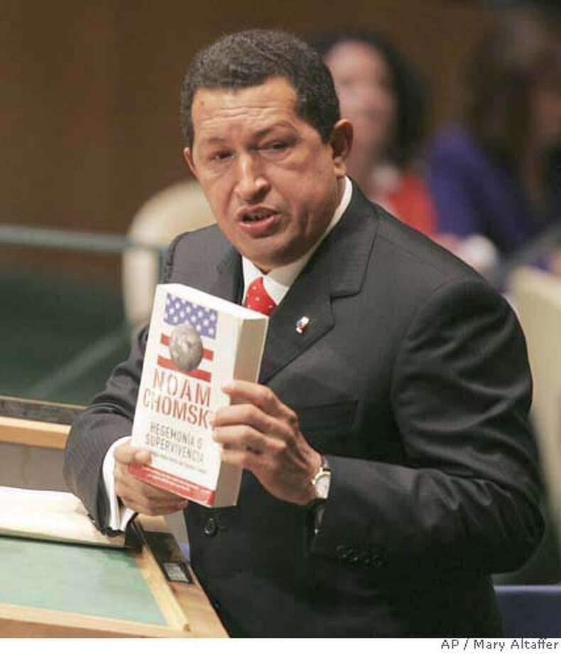 "Venezuela's President Hugo Chavez holds up a Spanish language copy of Noam Chomsky's book ""Hegemony or Survival: America's Quest for Global Dominance "" during his address to the 61st session of the United Nations General Assembly at U.N. headquarters, Wednesday Sept. 20, 2006. (AP Photo/Mary Altaffer) Photo: MARY ALTAFFER"
