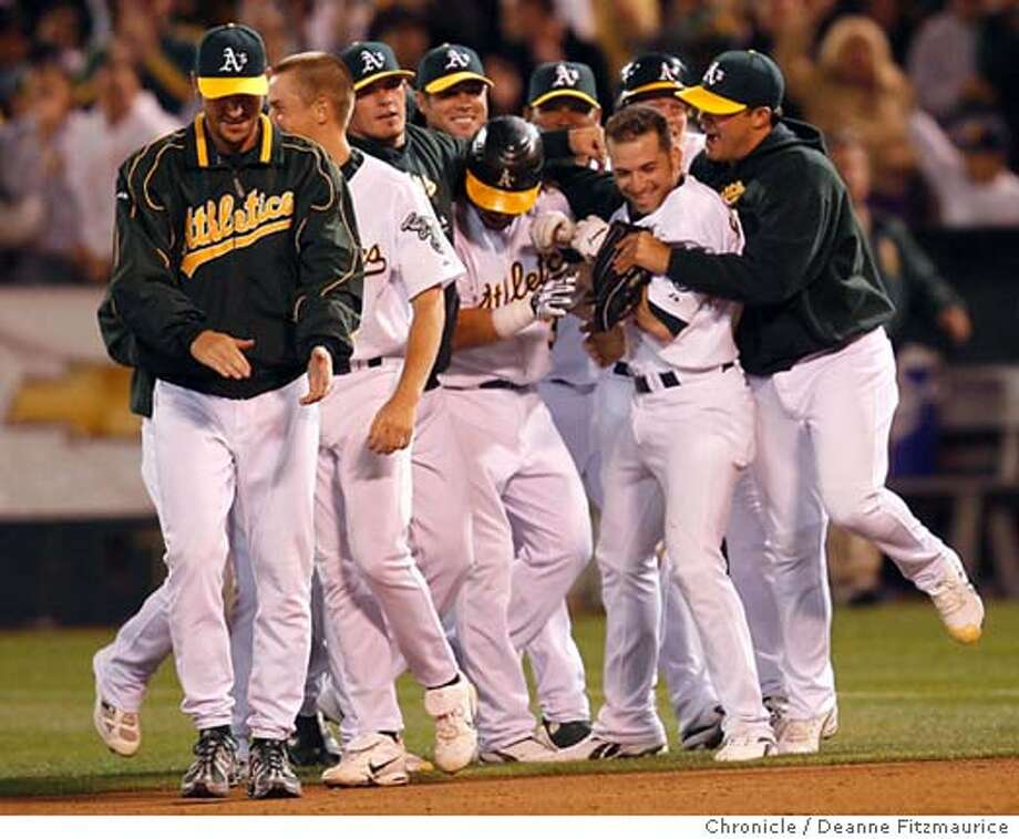 Marco Scutaro hits to win game in the 12th inning. Oakland Athletics play Los Angeles Angels at McAfee Coliseum in Oakland on 9/22/06.  (Deanne Fitzmaurice/ The Chronicle) Photo: Deanne Fitzmaurice