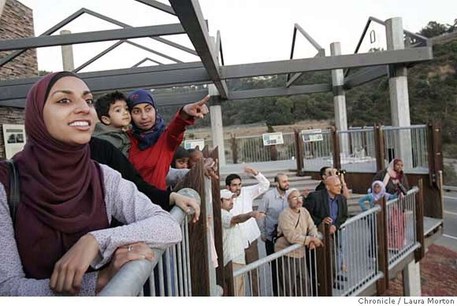 Bay Area muslims including Shereen Khan, Ilyas Isaaq, and Shahana Banth (left to right) gather in the Oakland Hills to look for a glimpse of the new moon, which traditionally signals the beginning of Ramadan, the holiest month of the Islamic calendar. MANDATORY CREDIT FOR PHOTOGRAPHER AND SAN FRANCISCO CHRONICLE/ -MAGS OUT Photo: Laura Morton