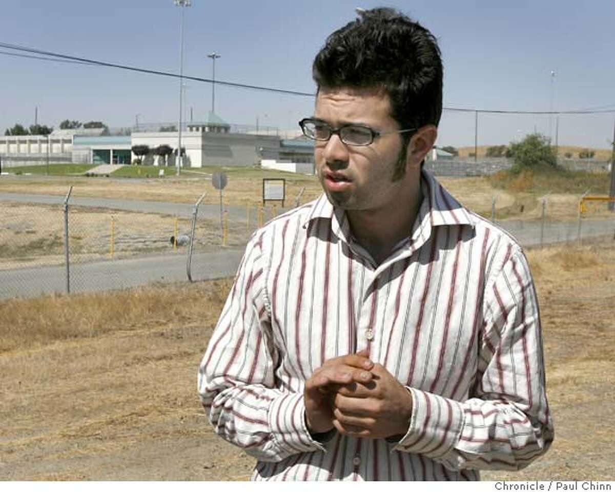 Freelance journalist Josh Wolf speaks to the media before he turns himself in at the Federal Correctional Facility (background) in Dublin, Calif. on Friday, September 22, 2006. Wolf was ordered back to prison by a federal court judge for refusing to hand over videotape footage Wolf shot of a police car being set on fire during a G-8 demonstration. PAUL CHINN/The Chronicle **Josh Wolf