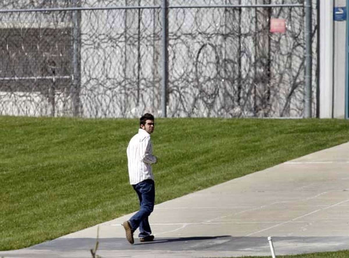 Freelance journalist Josh Wolf turns himself in at the Federal Correctional Facility in Dublin, Calif. on Friday, September 22, 2006. Wolf was ordered back to prison by a federal court judge for refusing to hand over videotape footage Wolf shot of a police car being set on fire during a G-8 demonstration. PAUL CHINN/The Chronicle **Josh Wolf