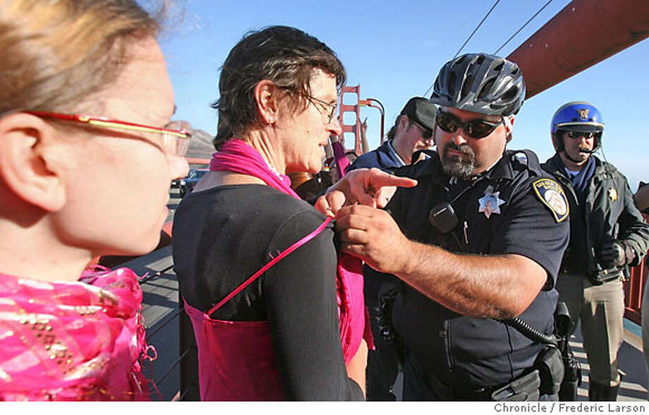 Toby Blome (left center)standing next to Kristen Flowers (far left) phyically had a protest sign (No War) pinned to herself removed by the GGBridge police. A number of protesters with the group Code Pink march from both ends of the Golden Gate Bridge in a protest against the war in Iraq which fouled up the morning commute. A handful of protester placed protest signs (No War)on themselves and where force to remove them by Bridge police. 9/22/06  { /The Chronicle} Photo: Frederic Larson