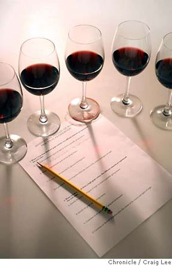 MASTER22_042_cl.JPG  Illustrative photo on what it takes to pass the Master Sommelier and Master of Wine exams. A flight of wine glasses surrounded by an exam sheet.  Craig Lee / The Chronicle MANDATORY CREDIT FOR PHOTOG AND SF CHRONICLE/ -MAGS OUT Photo: Craig Lee