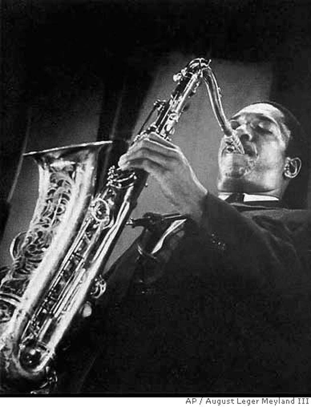 Jazz great John Coltrane plays in this undated photo. (AP Photo/August Leger Meyland III)