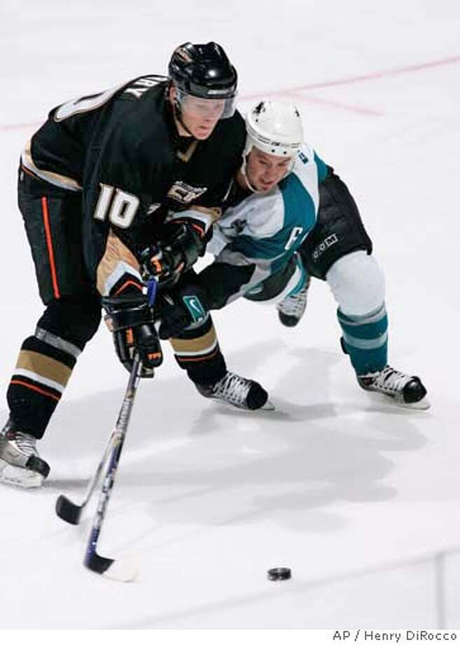 Anaheim Ducks' Corey Perry and San Jose Sharks Josh Georges battle for the puck in the third period of their NHL hockey game Wednesday night, Sept. 20, 2006, in Anaheim, Calif. The Ducks won with a final score of 6-3. (AP Photo/Henry DiRocco) Photo: HENRY DIROCCO