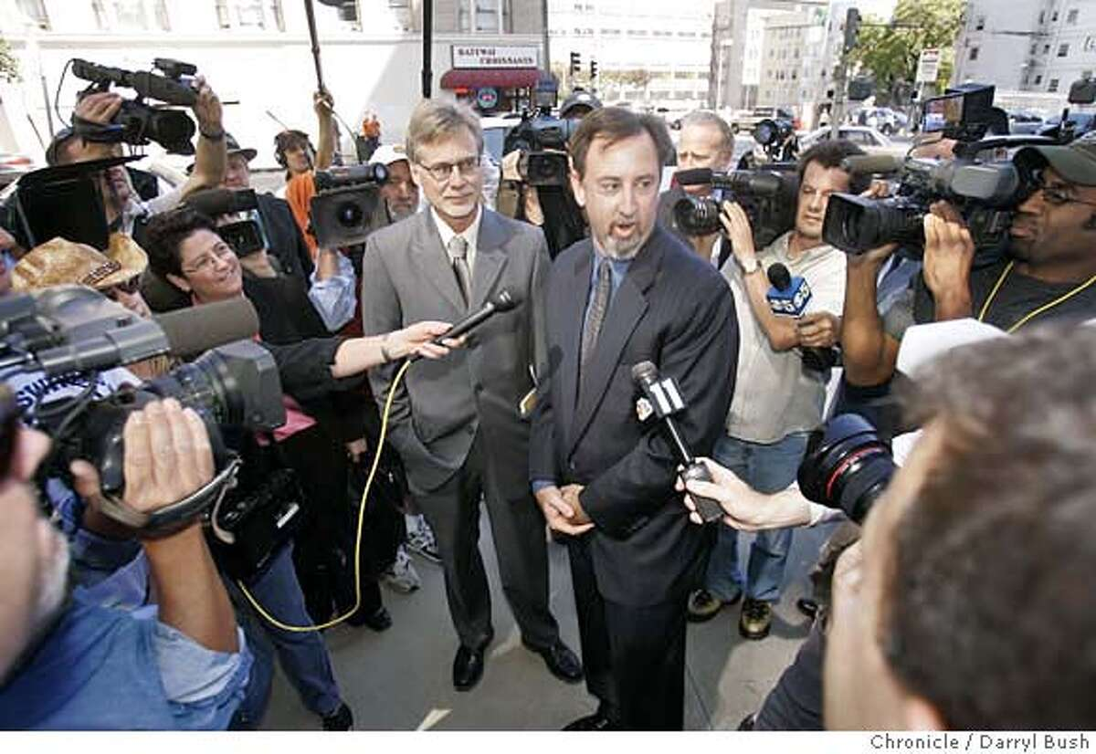 Chronicle writers, Lance Williams, left, and Mark Fainaru-Wada, right, (both center) talk to the media outside the Federal Courthouse as they arrive to face a judge that will decide their fate in the BALCO case in San Francisco, CA on Thursday, September 21, 2006. 9/21/06 Darryl Bush / The Chronicle ** (cq)