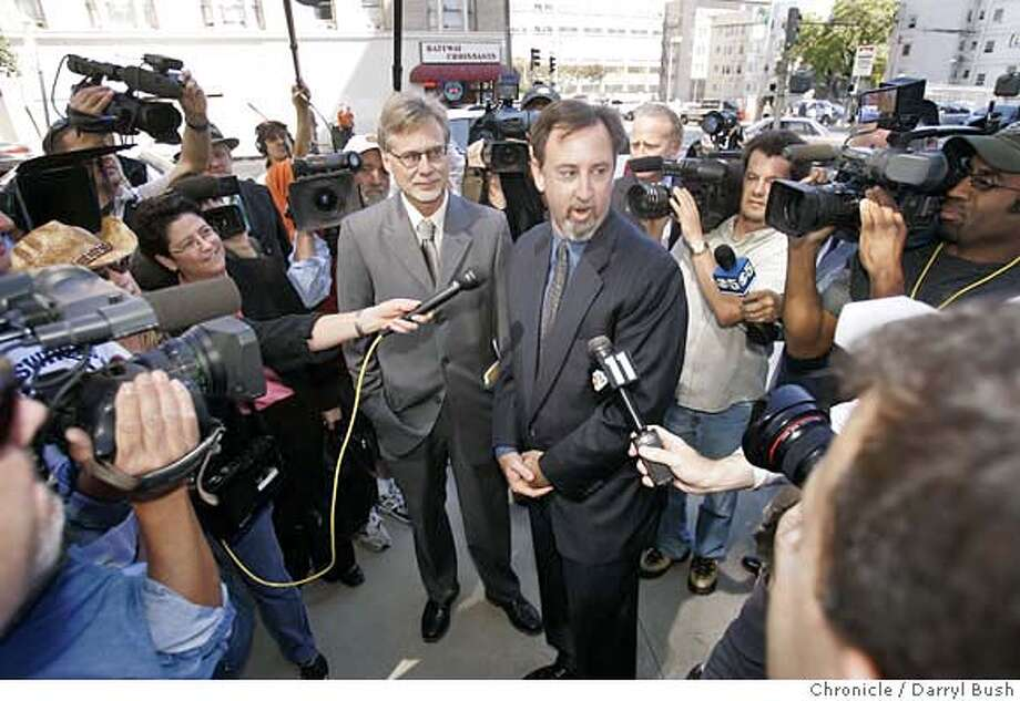 Chronicle writers, Lance Williams, left, and Mark Fainaru-Wada, right, (both center) talk to the media outside the Federal Courthouse as they arrive to face a judge that will decide their fate in the BALCO case in San Francisco, CA on Thursday, September 21, 2006. 9/21/06  Darryl Bush / The Chronicle ** (cq) Photo: Darryl Bush