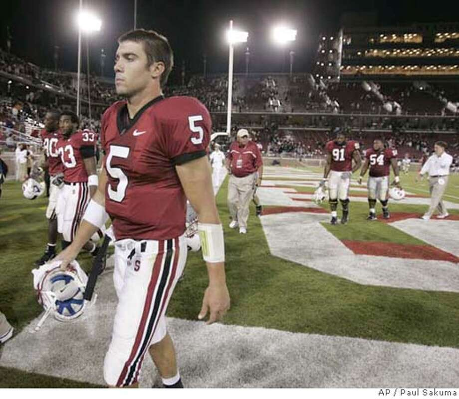 Stanford quarterback Trent Edwards walks off the field after Stanford lost 37-9 to Navy in a football game Saturday, Sept. 16, 2006, in Stanford, Calif. (AP Photo/Paul Sakuma) EFE OUT Photo: PAUL SAKUMA
