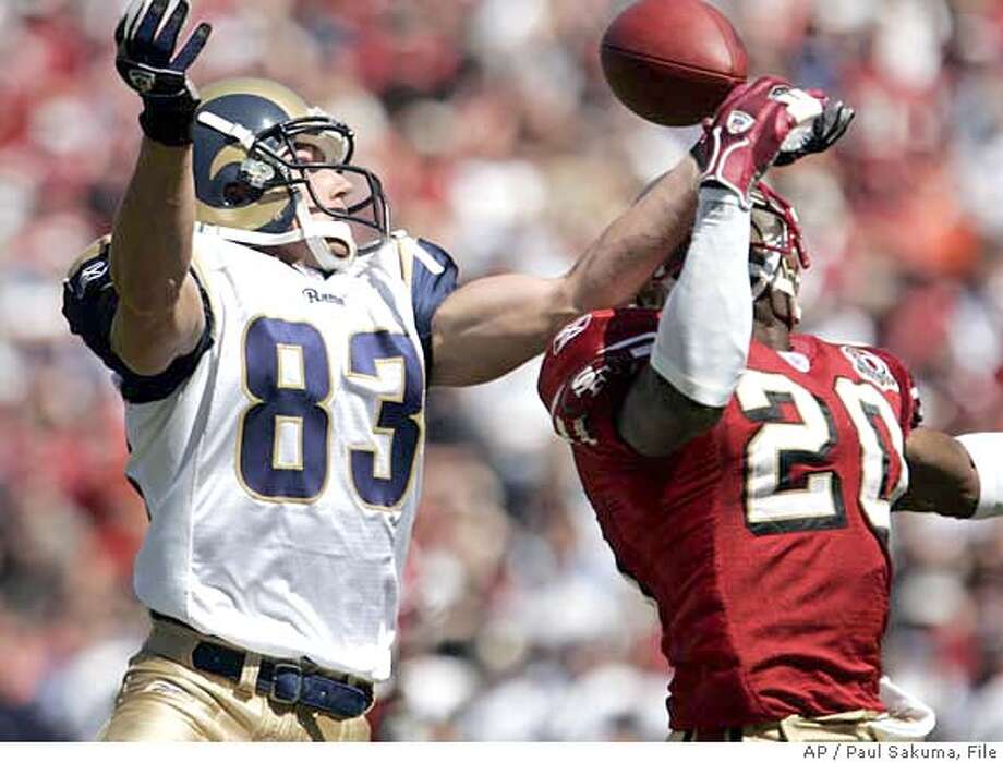 San Francisco 49ers safety Mike Adams (20) breaks up a pass to St. Louis Rams wide receiver Kevin Curtis (83) in the first quarter of an NFL football game, Sunday, Sept. 17, 2006, in San Francisco. (AP Photo/Paul Sakuma) EFE OUT Photo: PAUL SAKUMA