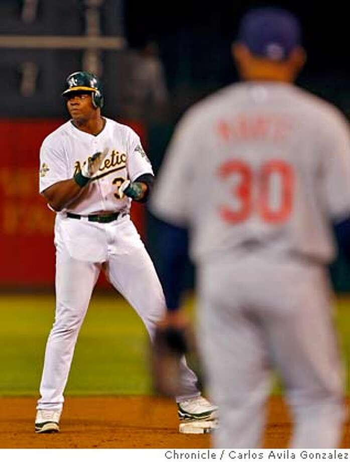 ATHLETICS21_008_CAG.JPG  Frank Thomas joins the crowd in giving himself a little applause at second after his two-run double in the seventh inning. The Oakland Athletics played the Cleveland Indians at McAfee Coliseum in Oakland, Ca., on Wednesday, September 20, 2006.  Photo by Carlos Avila Gonzalez/The San Francisco Chronicle  Photo taken on 9/20/06, in Oakland, Ca, USA  **All names cq (source) MANDATORY CREDIT FOR PHOTOG AND SAN FRANCISCO CHRONICLE/ -MAGS OUT Photo: Carlos Avila Gonzalez