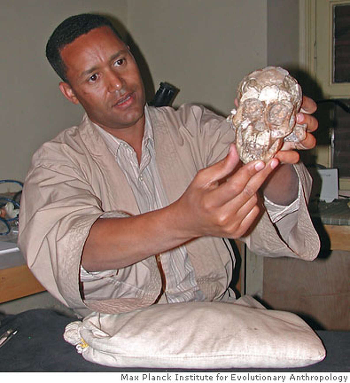 ** IMAGE EMBARGOED UNTIL SEPT. 20 AT 1 PM EDT **This undated photo provided by the Max Planck Institute for Evolutionary Anthropology, shows Dr. Zeresenay Alemseged holding the skull of a three-year-old Australopithecus afarensis at the National Museum of Ethiopia in Addis Ababa, Ethiopia. Scientists have discovered the remarkably complete skeleton of the 3-year-old female from the ape-man species represented by