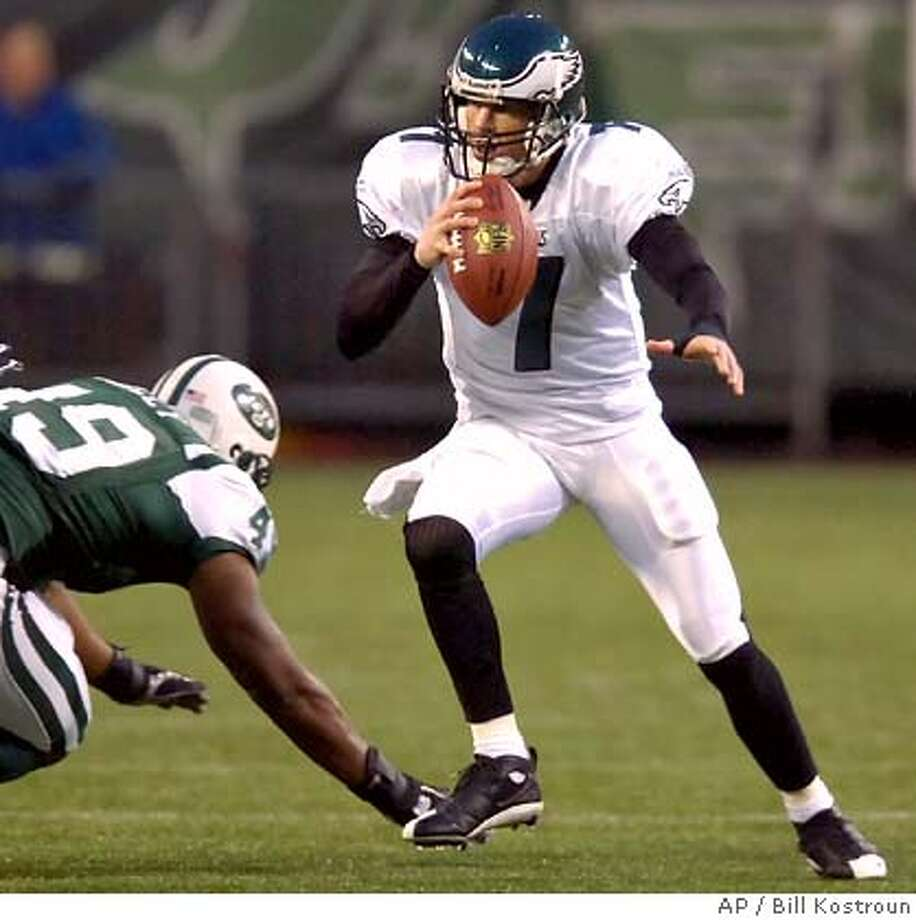 Philadelphia Eagles quarterback Jeff Garcia, right, avoids a tackle by New York Jets linebacker Craig Bailey during first quarter NFL football Friday night, Sept. 1, 2006, at Giants Stadium in East Rutherford, N.J. The Jets beat the Eagles, 20-17. (AP Photo/Bill Kostroun) Photo: BILL KOSTROUN