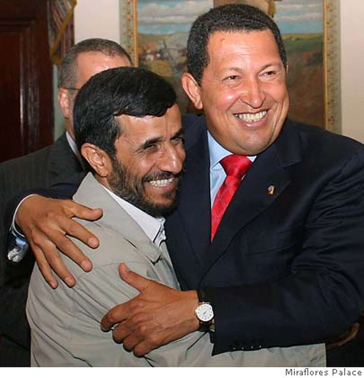 Iran's President Mahmoud Ahmadinejad (L) is welcomed by Venezuela's President Hugo Chavez at Miraflores Palace in Caracas September 17, 2006. Ahmadinejad shored up opposition to a U.S. drive to curb Iran's nuclear program on a visit to Venezuela on Sunday that cemented an anti-American front with Chavez. EDITORIAL USE ONLY REUTERS/Miraflores Palace/Handout (VENEZUELA) 0