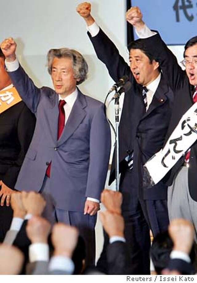Japan's Chief Cabinet Secretary Shinzo Abe (C), flanked by Japan's Prime Minister Junichiro Koizumi (L), raises his arm after he is elected as head of the ruling Liberal Democratic Party (LDP) at the LDP headquarters in Tokyo September 20, 2006. Abe, a conservative advocate of a more muscular Japanese foreign policy, was overwhelmingly elected as ruling party leader on Wednesday, setting the stage for him to be chosen prime minister next week. REUTERS/Issei Kato (JAPAN) 0 Photo: ISSEI KATO