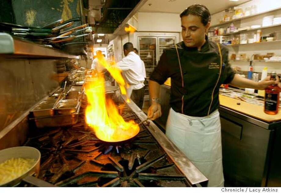 Mantra's chef Sachin Chopra works in his kitchen, Monday Aug, 21, 2006 in Palo Alto, Ca. Mantra a new upscale Indian restaurant in Palo Alto.  Lacy Atkins/The Chronicle) Ran on: 09-10-2006  Mantra's tandoori mixed grill is an array of roasted rack of lamb, red-spiced nuggets of chicken, yellow saffron shrimp and minted sea bass gently cooked in the oven.  Ran on: 09-21-2006  Chef Sachin Chopra combines California sensibility with Indian flavors at Mantra in Palo Alto. Photo: Lacy Atkins