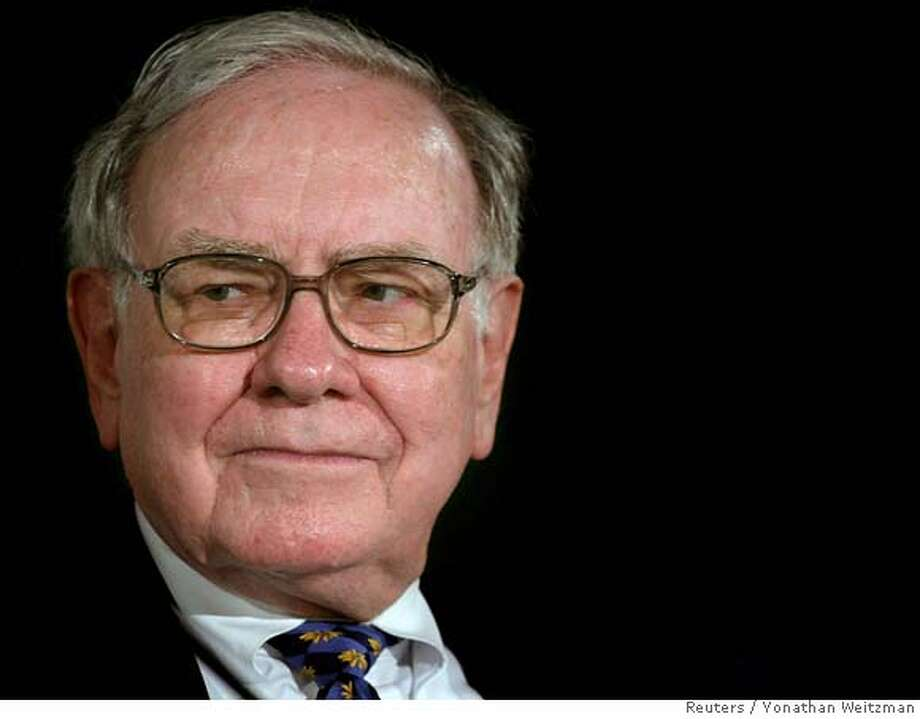 U.S. billionaire investor Warren Buffett attends a news conference in Tefen industrial zone in northern Israel September 18, 2006. Buffett said on Monday during a visit to Israel that his investment company Berkshire Hathaway Inc. was interested in acquiring further utility companies in the coming years. REUTERS/Yonathan Weitzman (ISRAEL) 0 Photo: YONATHAN WEITZMAN