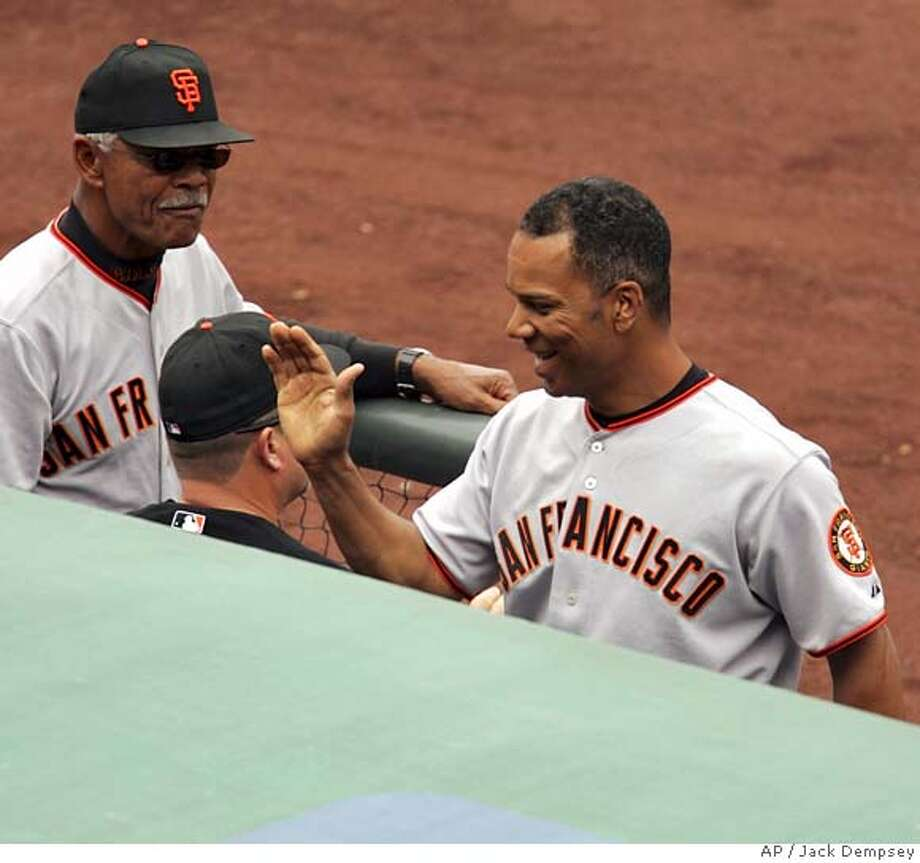 San Francisco Giants' Moises Alou, right, celebrates his two-run home run off Colorado Rockies relief pitcher Ray King as manager Felipe Alou, left, looks on during the seventh inning of a baseball game in Denver, Wednesday, Sept. 20. 2006. (AP Photo/Jack Dempsey) Photo: JACK DEMPSEY