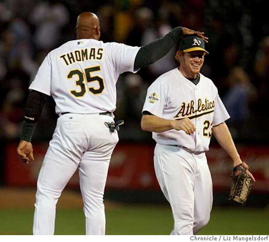 Bobby Kielty is congratulated by Frank Thomas after the game. Kielty hit a grand slam in the 6th inning.  Oakland A's v. the cleveland Indians at McAfee Stadium on Sept. 19, 2006.  Liz Mangelsdorf /The Chronicle Ran on: 09-20-2006  Bobby Kielty gets a pat on the head from Frank Thomas after hitting his first career grand slam for the A's. Photo: Liz Mangelsdorf