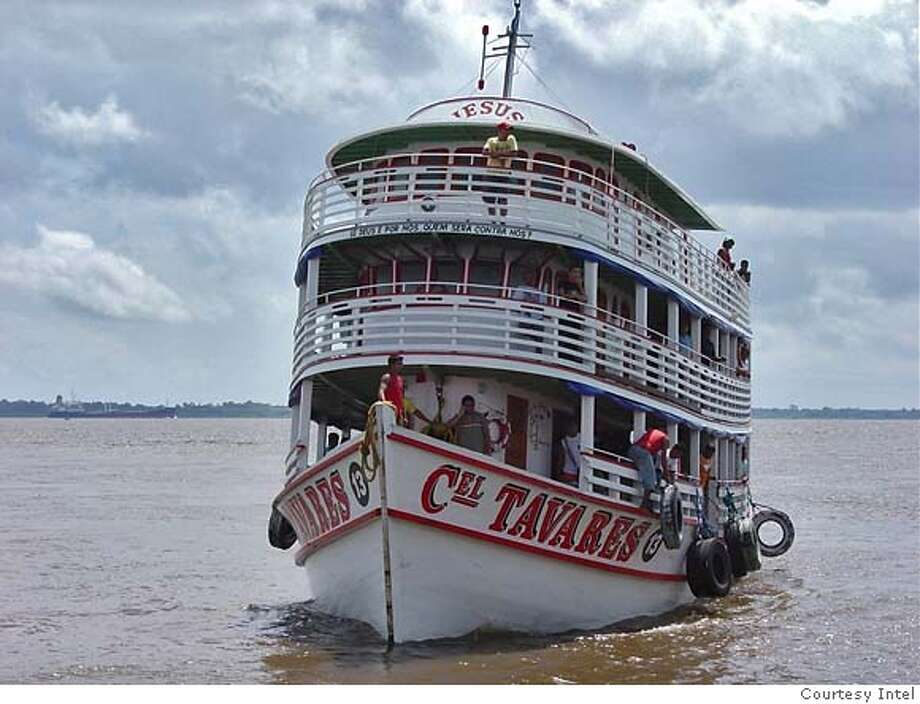 In one of the most remote inhabited places on Earth, the Amazon, Intel Corporation has created a wireless, high-speed Internet network for residents and donated computers to help improve local healthcare and education for the 114,000 residents of Parintins, Brazil. A boat transporting 60 desktop computers for computer labs at two schools pulls into the island city's port. Photo: Courtesy Intel