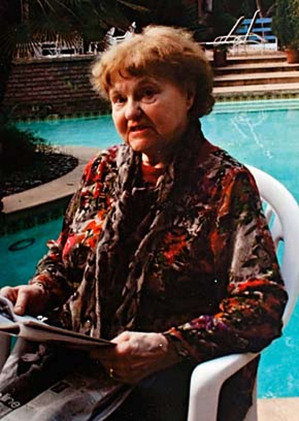 NAZI20_019_KW_.jpg On Tuesday September 19, 2006 a copy photo of a December 24, 2005 Christmas family snap shot of Elfriede Rinkel taken in Los Angeles. According to family members, Rinklel immigrated from Germany to the United states in 1959 and lived in San Francisco until she was deported back to Germany at 83-years-old after federal officials uncovered her past as a Nazi concentration camp guard. Her family claims they never knew anything about her past and believed she worked for a furrier in Germany during the war. Handout ** cq