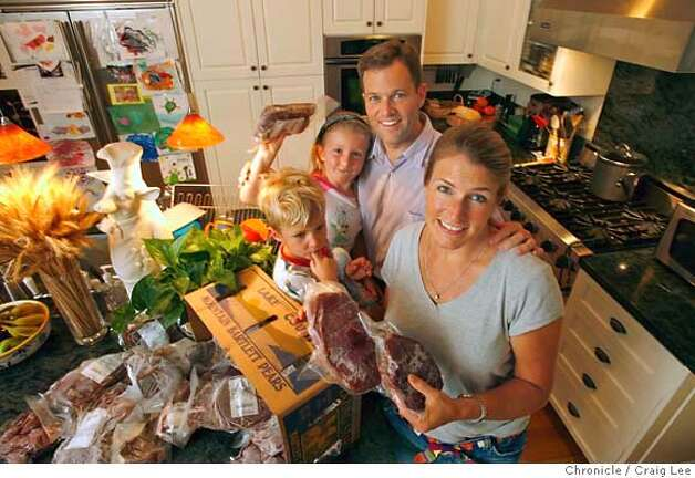 MEAT20_family_060_cl.JPG  Food story about a trend toward more people buying meat directly from ranchers and farmers. Photo of the Hagan family, Jeff and his wife, Katie, with their two kids, Colin, 3, and Maddy, 5, in their kitchen with their frozen Morris Grassfed Beef the counter. Craig Lee / The Chronicle MANDATORY CREDIT FOR PHOTOG AND SF CHRONICLE/ -MAGS OUT Photo: Craig Lee