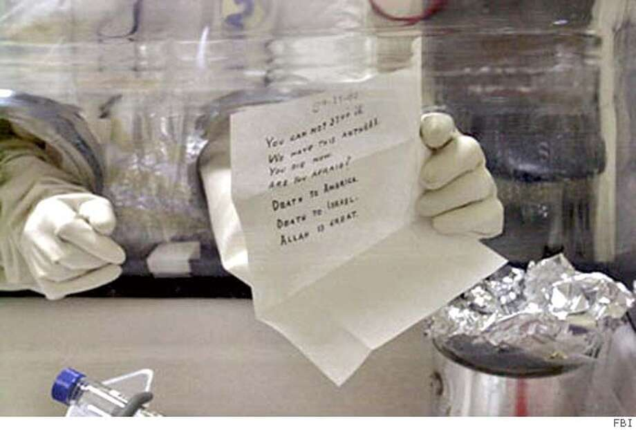 ANTHRAX-C-25DEC01-MT-OTHER --- (NYT4) UNDATED -- Dec. 25, 2001 -- ANTHRAX-INQUIRY -- Medical investigators have done much to contain the anthrax outbreak and save lives. Yet the inside story of the very first inquiry - pieced together from interviews with many of the lead investigators and other health-care officials - is also a tale of missed cues, misread evidence and erroneous assumptions that led scientists and decision-makers to misjudge the threat to postal workers and, through the mail system, to the American public. A technician at the Army's Ft. Detrick biomedical research laboratory in Ft. Detrick, Md. opens a letter addressed to Sen. Patrick Leahy, D-Vt., found in the sequestered congressional mail on Nov.16, 2001. The envelope contained a quantity of a substance believed to be anthrax. (FBI/The New York Times) (BY ) Photo: FBI/New York Times