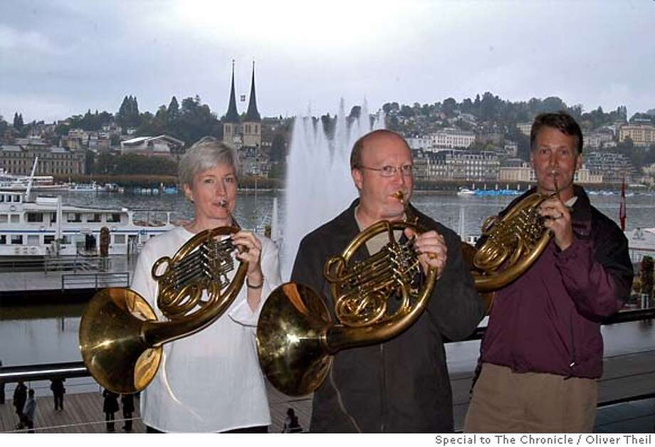 SFS horn players (l-r) Kimberly Wright, Robert Ward, and Bruce Roberts warming up in a scenic spot before their Lucerne Festival performance of Mahler's Symphony No. 8. Photo credit: Oliver Theil, special to the Chronicle Photo: Oliver Theil, Special