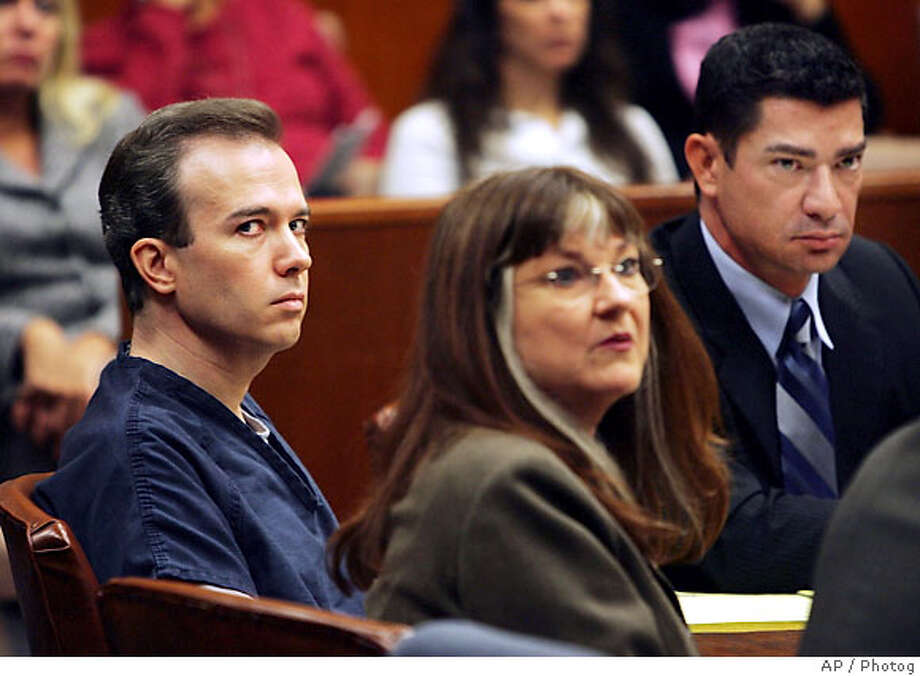 John Mark Karr, left, appears with his lawyers Rob Amparan, right, and Gayle Gutekunst in Sonoma County Superior Court before Judge Cerena Wong on Thursday, Sept. 14, 2006 in Santa Rosa, Calif. Karr, the man who confessed to murdering JonBenet Ramsey only to be exonerated, plans to fight the five-year-old misdemeanor child pornography charges he faces in California, his defense lawyer said Thursday. (AP Photo/John Burgess, pool) Photo: JOHN BURGESS