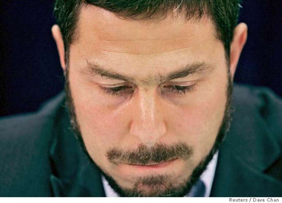 Maher Arar pauses during a news conference in Ottawa September 18, 2006. Canadian police wrongly identified Arar, an Ottawa software engineer, as an Islamic extremist, prompting U.S. agents to deport him to Syria, where he says he was tortured, an official inquiry concluded. REUTERS/Dave Chan (CANADA) Photo: DAVE CHAN