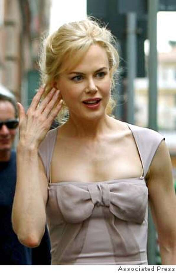 "Actress Nicole Kidman gestures as she walks in central Rome, Saturday Sept. 9, 2006. As the world's oldest running film festival, the Venice Biennale, gears itself up to award on its last day (Saturday) the Golden Lion award, Kidman was seen in Rome where on Oct. 16 she will attend the opening of the first edition of a film festival in the Eternal City for the world premier of ""Fur,"" a film combining biography and fictional romance based loosely on the life of photographer Diane Arbus played by Kidman. The city of Rome's decision to launch a festival of its own just two months after the venerable Venice Film Festival, which opened its 63rd showing on Wednesday Aug. 30th, erupted into a full-blown spat that mirrors centuries-old rivalries between the Eternal City and the Most Splendid Republic. (AP Photo) Photo: Ap"
