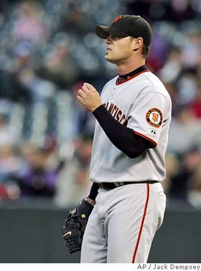 San Francisco Giants starting pitcher Noah Lowry looks to the outfield after giving up a run to the Colorado Rockies during the first inning of a baseball game in Denver, Monday, Sept. 18, 2006. (AP Photo/Jack Dempsey) Photo: JACK DEMPSEY
