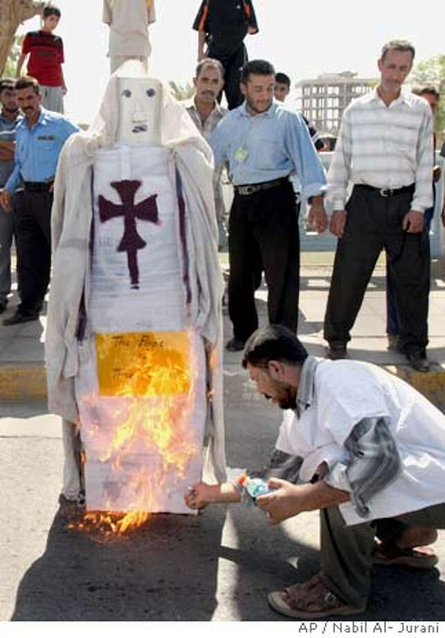 "Iraqis burn an effigy of Pope Benedict XVI during a demonstration, in Basra, Iraq's second-largest city, 550 kilometers (340 miles) southeast of Baghdad, Monday Sept.18, 2006.The demonstration was against his speech last week in Germany, particularly his quoting of a medieval text that characterized some of the teachings of Islam's founder as ""evil and inhuman"" and referred to spreading Islam ""by the sword."" Benedict said Sunday that he is ""deeply sorry"" his remarks on Islam. (AP Photo/Nabil Al- Jurani) Photo: NABIL AL JURANI"