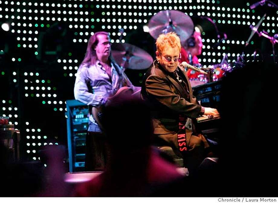Elton John performs during a concert at the HP Pavilion in San Jose, CA on Saturday, September 16, 2006. MANDATORY CREDIT FOR PHOTOGRAPHER AND SAN FRANCISCO CHRONICLE/ -MAGS OUT Photo: Laura Morton