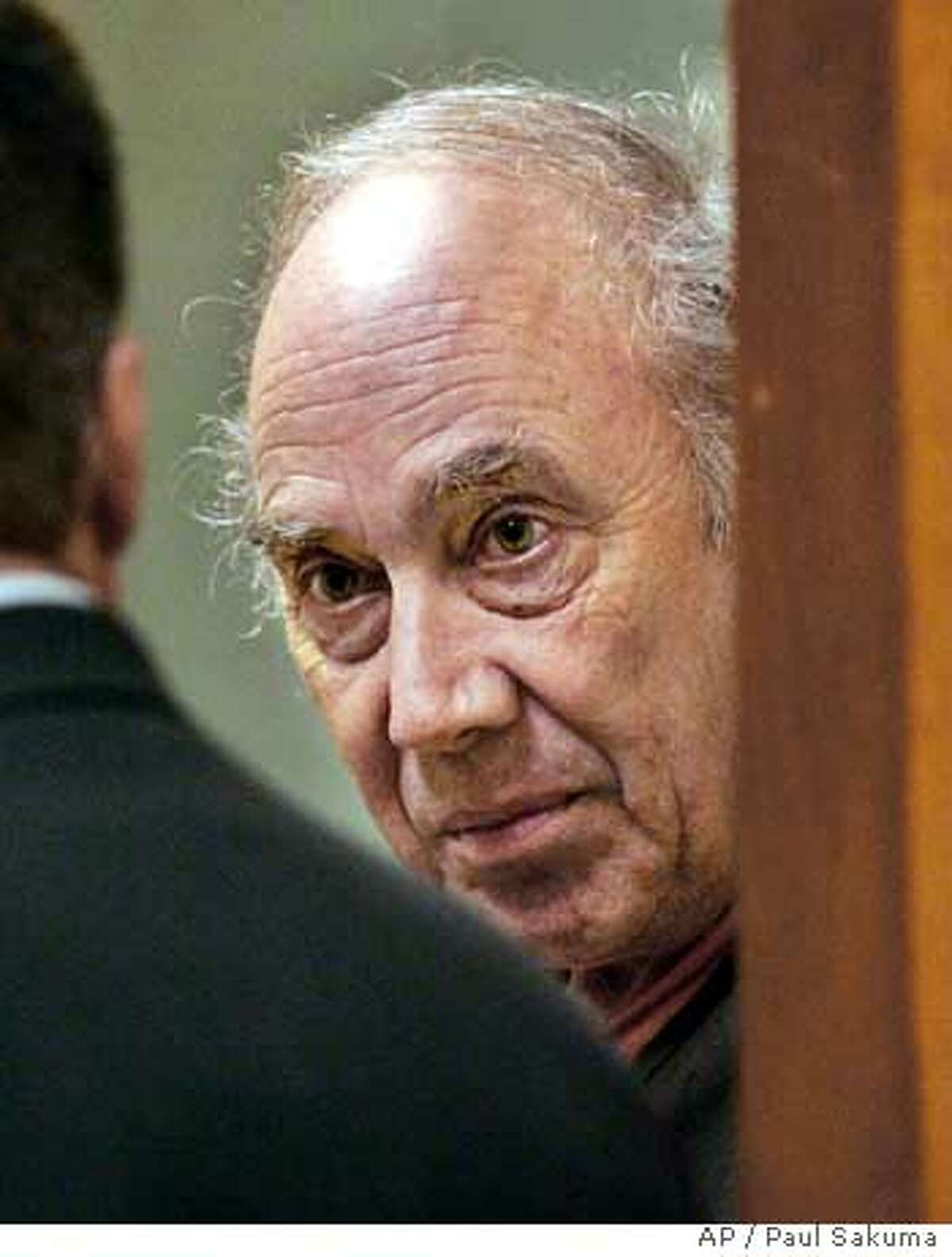 ** FILE **Dean Arthur Schwartzmiller, right, is shown in a doorway of a San Jose, Calif., courtroom, Wednesday, June 22, 2005, during a scheduled court appearance, as he listens to his attorney, public defender Ken Mandel, at left. Schwartzmiller, charged with abusing two 12-year-old boys, was set to appear in court Wednesday, Nov. 16, 2005 for a preliminary hearing. He has pleaded not guilty to the charges. (AP Photo/Paul Sakuma) Ran on: 11-17-2005 Dean Arthur Schwartzmiller has pleaded not guilty to seven counts in the alleged molestation of two boys. Ran on: 08-29-2006 Dean Schwartz- miller has sex crimes convictions in other states; two verdicts were overturned.
