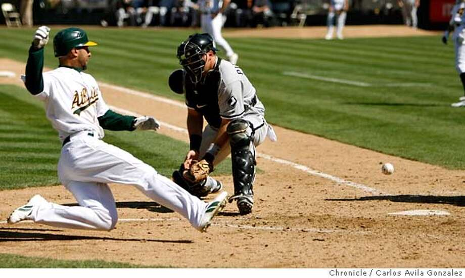 ATHLETICS18_004_CAG.JPG  Oakland's Jay Payton comes in to score a run as the ball gets away from Chicago's catcher, A.J. Pierzynksi in the bottom of the sixth inning on a Mark Ellis sacrifice fly. The Oakland Athletics played the Chicago White Sox at McAfee Coliseum on Sunday, September 17, 2006. The Athletics beat the Sox 5-4, sweeping the series. Photo by Carlos Avila Gonzalez/The San Francisco Chronicle  Photo taken on 9/17/06, in Oakland, Ca, USA  **All names cq (source) Photo: Carlos Avila Gonzalez