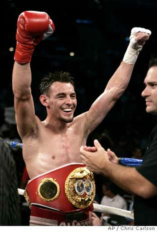 Robert Guerrero reacts after winning his bout against Eric Aiken in the eight round of their IBF featherweight championship boxing match in Los Angeles, Saturday, Sept. 2, 2006. (AP Photo/Chris Carlson) Photo: CHRIS CARLSON