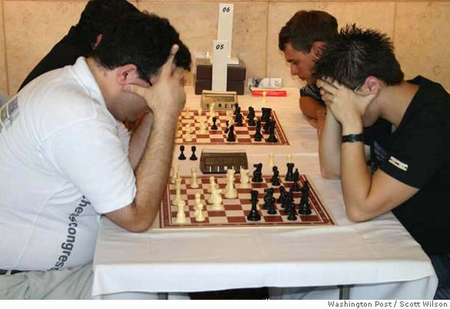 """Emil Sutovsky, left, an Israeli chess grandmaster, faces Gaby Livshitz in the World Blitz Championship of chess in Rishon Letzion, Israel. Sutovsky, the first Israeli to win the European Individual Championship, did not disappoint his fans. """"It quickly went bad,"""" Livshitz says. Illustrates ISRAEL-CHESS (category i), by Scott Wilson (c) 2006, The Washington Post. Moved Tuesday, Sept. 12, 2006. (MUST CREDIT: Washington Post photo by Scott Wilson.) Photo: SCOTT WILSON"""