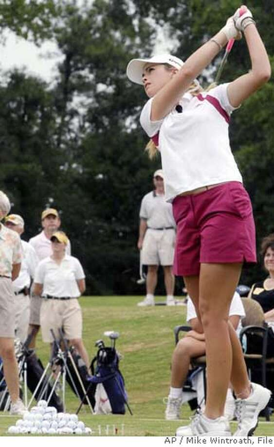 Paula Creamer, a professional golfer on the LPGA Tour, demonstrates golf technique during a golf clinic, Monday, Sept. 4, 2006 at the First Tee of Arkansas in Little Rock, Ark. (AP Photo/Mike Wintroath) EFE OUT Photo: MIKE WINTROATH