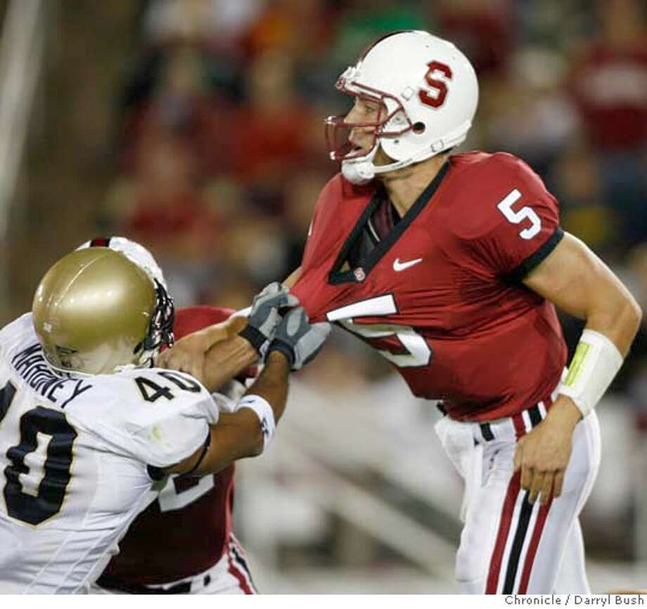 stanford_0015_db.JPG  Stanford quarterback Trent Edwards is grabbed following a pass by Navy David Mahoney in the 2nd qtr. vs. Navy at New Stanford Stadium in Stanford, CA on Saturday, September 16, 2006. 9/16/06  Darryl Bush / The Chronicle ** (cq) MANDATORY CREDIT FOR PHOTOG AND SF CHRONICLE/ -MAGS OUT Photo: Darryl Bush