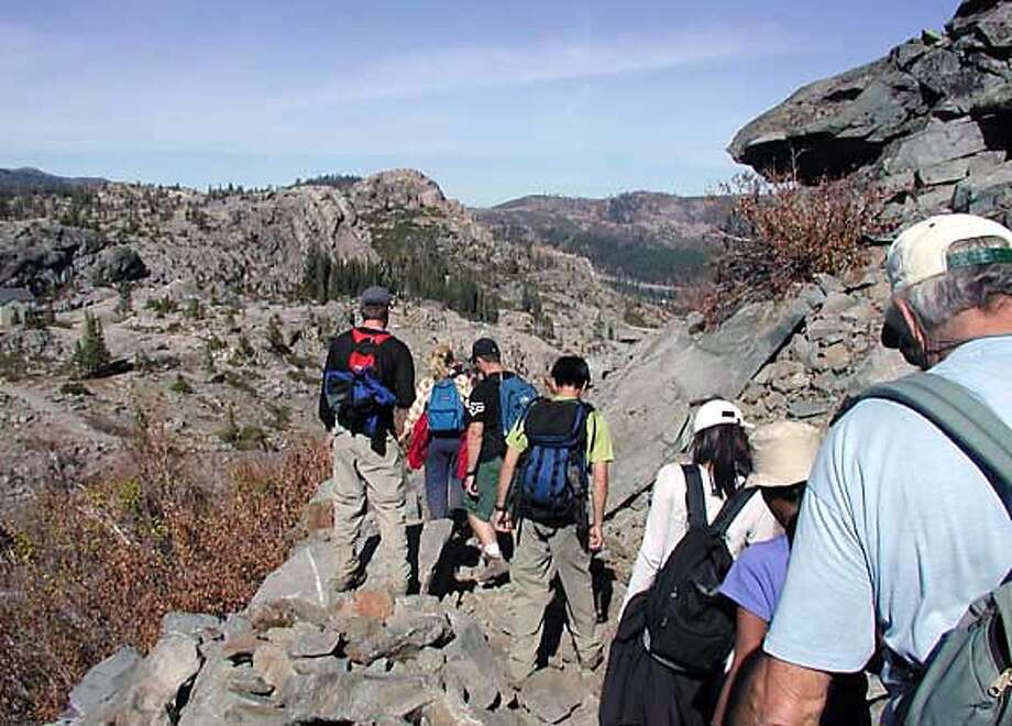 Hikers follow the path of the ill-fated attempt to cross what is now known as Donner Pass. Photo by Gary Henthorn