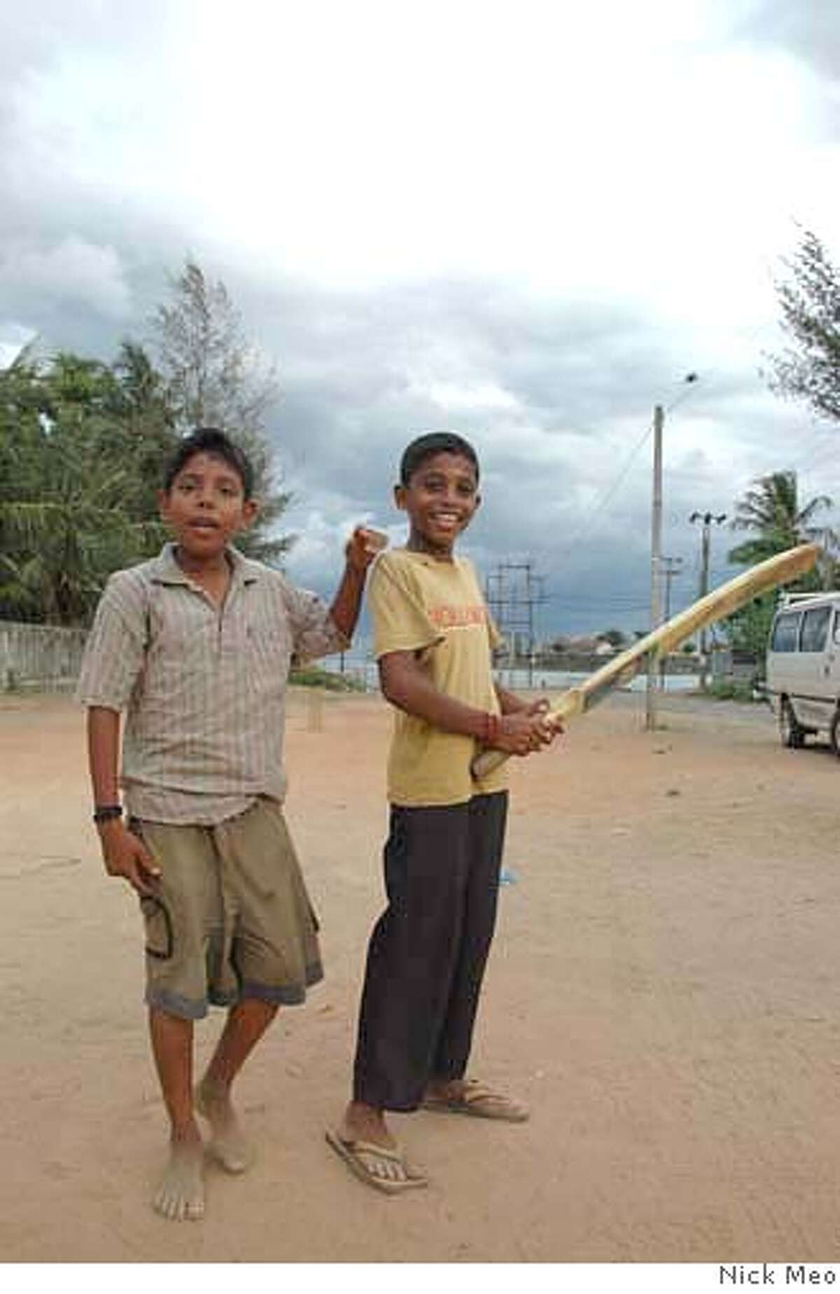 Pictures show boys playing cricket in the town of Batticaloa. Boys not much older than these are recruited by the LTTE. Liberation Tigers of Tamil Eelam are again recruiting children as soldiers as fighting spreads in Sri Lanka . All pix by Nick Meo - in Indonesia on 0062 81584450316