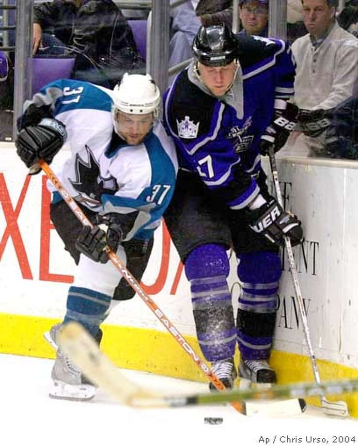 San Jose Sharks' Curtis Brown tangles with Los Angeles Kings' Lubomir Visnovsky of Slovakia during the first period on Wednesday, March 31, 2004, in Los Angeles. (AP Photo/Chris Urso) Sharks' Nils Ekman (left), goalie Evgeni Nabokov (20), Brad Stuart and Mike Rathje (2) after the Sharks beat the Kings and clinched the Pacific Division. ALSO RAN:07-03-2004 Photo: CHRIS URSO