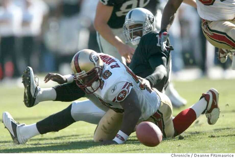 RAIDERS2-C-03NOV02-SP-DF  Brandon Moore recovers Araiders fumble on the 16 yard line 1st quarter to set up a 49er TD . 49ers vs Raiders at Network Associates Coliseum in Oakland.  CHRONICLE PHOTO BY DEANNE FITZMAURICE Photo: DEANNE FITZMAURICE