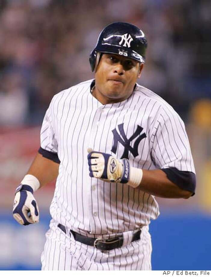 New York Yankees Bobby Abreu heads toward third base after hitting a three run home run against the Tampa Bay Devil Rays during the first inning of their baseball game, Tuesday, Sept. 12, 2006, at Yankee Stadium in New York. (AP Photo/Ed Betz) Photo: ED BETZ