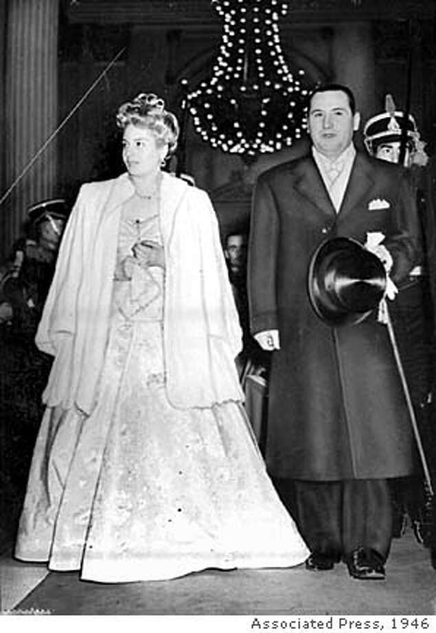 -- Juan Peron, new president of Argentina, accompanies his wife Eva, as they enter the Teatro Colon in Buenos Aires for a performance in their honor. This is the Perons' first formal public appearance since he took office. This photo is dated July 5, 1946. (AP Photo/files)  Ran on: 09-17-2006  In his first formal appearance after becoming Argentina's president, Juan Peron accompanies his wife, Eva, to the theater. Photo: Associated Press 1946