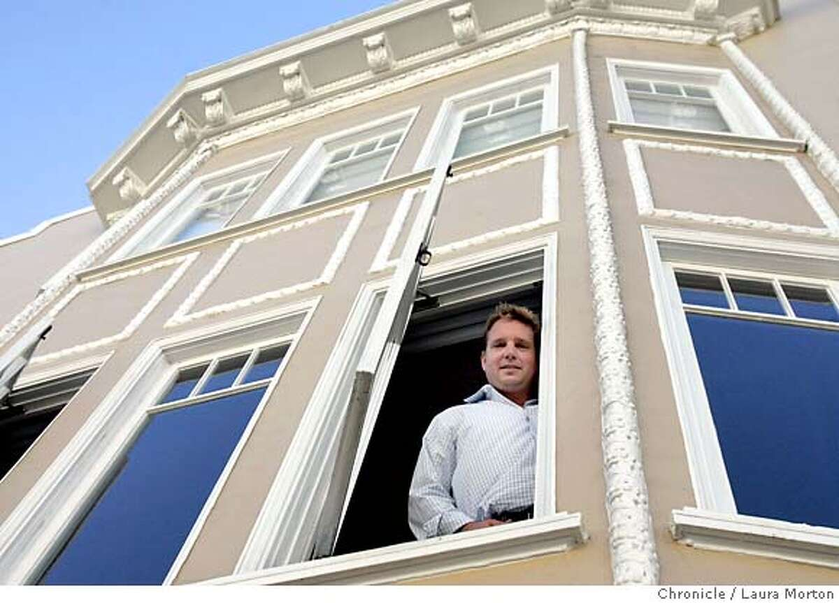 Secondhome236912_lkm.jpg Chris Hawkins poses in the window of his Marina condominium on Sunday, July 16, 2006. Hawkins lived in a smaller unit in the same building and was able to buy the condo he now lives in as well as keep the smaller one, which he now rents. Laura Morton/The Chronicle Ran on: 07-23-2006 Chris Hawkins stands in a window of his second Marina condominium. He rents out a smaller unit. Ran on: 07-23-2006 MANDATORY CREDIT FOR PHOTOGRAPHER AND SAN FRANCISCO CHRONICLE/ -MAGS OUT