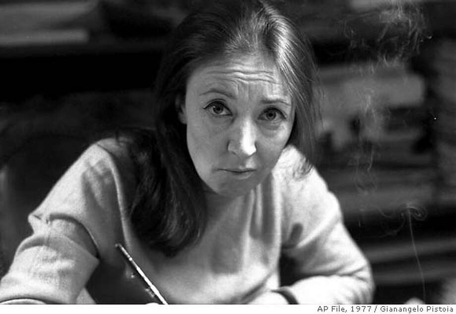 ** FILE ** A file photo of Italian veteran journalist and writer Oriana Fallaci taken in Los Angeles on April 4, 1977. Oriana Fallaci, a former war correspondent best known for her uncompromising interviews and provocative stances, has died in a Florence, Italy, hospital, Friday, Sept. 15, 2006. She was 76. (AP Photo/Gianangelo Pistoia) ** B/W ONLY ** APRIL 4, 1977 FILE PHOTO - ONLY BLACK AND WHITE AVAILABLE Photo: GIANANGELO PISTOIA