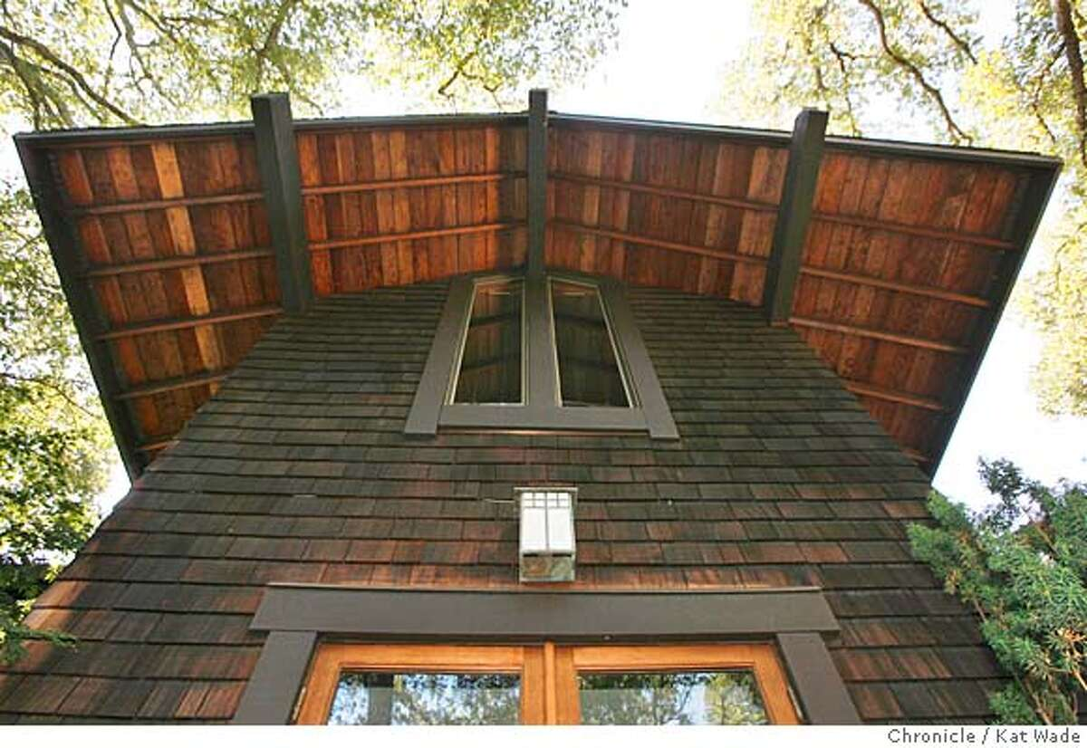 SIGSTYLE_BULL19_082_KW_.jpg A backyard view looking up at Charles and Barbara Bureker's home by Henrik Bull which has a Arts and Crafts feel on the exterior with the rustic theme carried inside with re-sawn redwood paneling in Alamo Tuesday August 8, 2006. Kat Wade/The Chronicle **Charles and Barbara Bureker (Subject) cq Mandatory Credit for San Francisco Chronicle and photographer, Kat Wade, Mags out