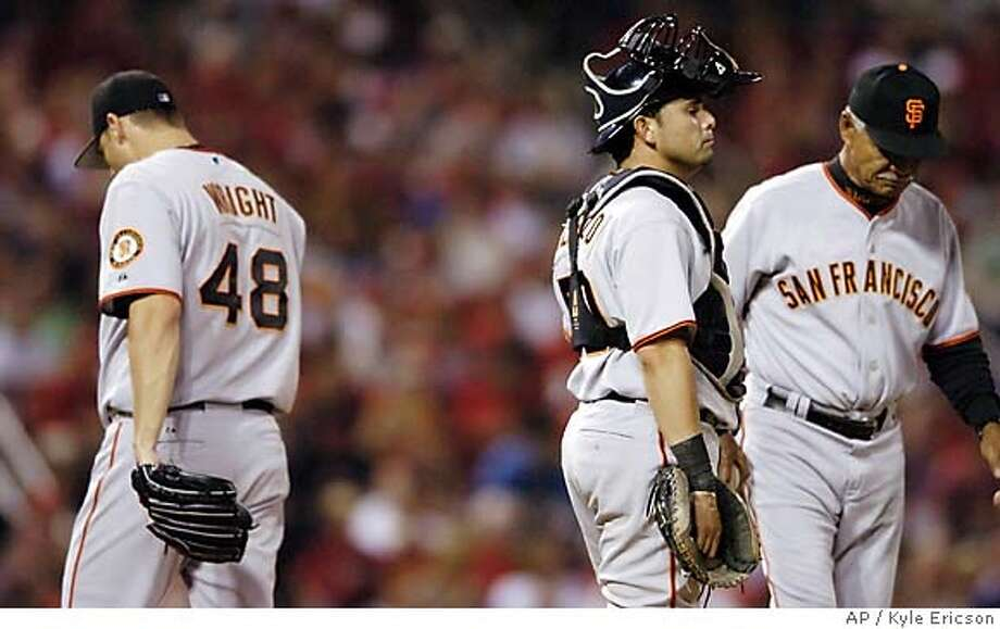 San Francisco Giants pitcher Jamey Wright, left, walks off the mound after being taken out of the game by manager Felipe Alou, right, as catcher Eliezer Alfonzo waits during the sixth inning of a baseball game against the St. Louis Cardinals on Friday, Sept. 15, 2006, in St. Louis. Scott Munter came in to pitch. (AP Photo/Kyle Ericson) Photo: KYLE ERICSON